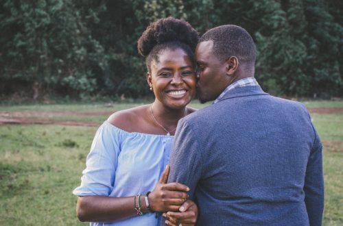 black man pecking girl