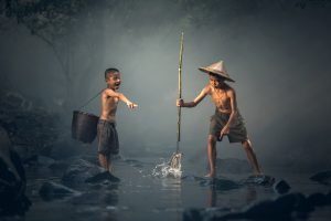 Kid catching fish