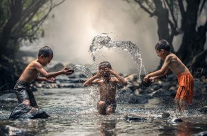 kids splashing in water